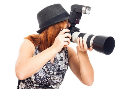 news flash: Young female photographer with professional camera, isolated on white background. Stock Photo