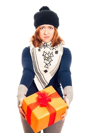 Angry disappointed woman holding gift box, isolated on white background. photo