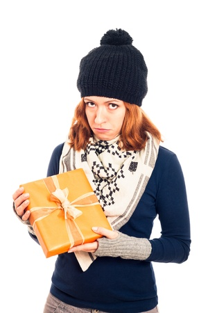 Unhappy disappointed sad woman holding gift box, isolated on white background. photo