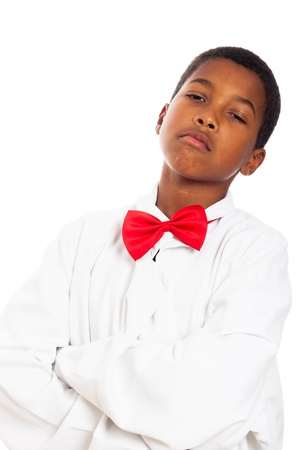 Portrait of serious child in scientist lab coat and red bow tie, isolated on white background. Stock Photo - 16959428