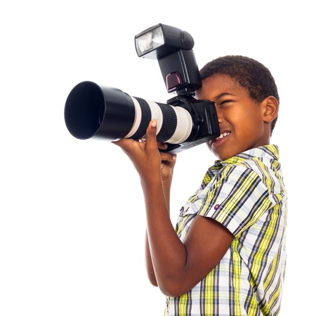 Child school boy taking photos with professional camera, isolated on white background.
