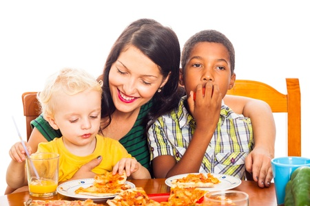 Young happy smiling woman with children eating pizza, isolated on white background. photo