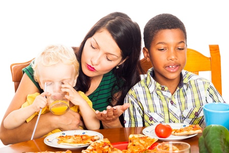 single parents: Young woman with children eating pizza and drinking juice, isolated on white background.