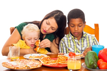 Young woman with kids eating pizza, isolated on white background. photo