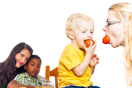Detail of happy women and children eating tomatoes, isolated on white background with copy space. photo