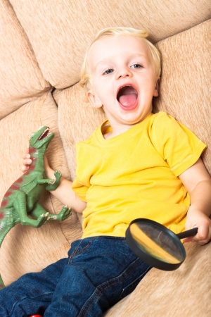 Close up of happy laughing child boy playing on sofa. Stock Photo - 16960552