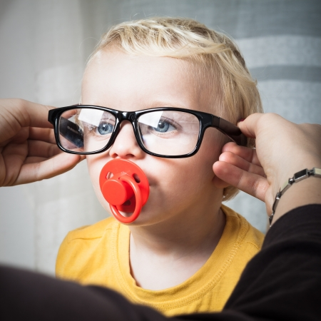Close up of cute toddler child boy wearing eyeglasses. Stock Photo - 16959479