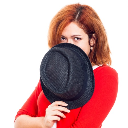 Young secret woman hiding face behind hat, isolated on white background. photo