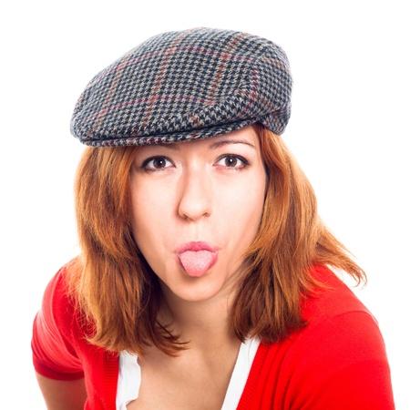 sacar la lengua: Joven, mujer, sacar la lengua, haciendo muecas, aislados en fondo blanco.