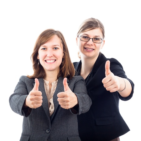 Two young happy business women gesturing thumbs up, isolated on white background. photo