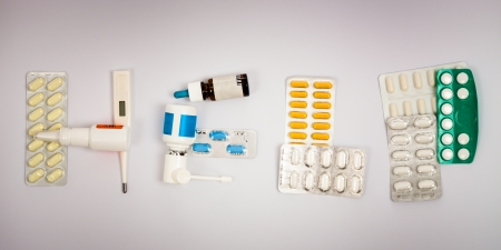 Pharmaceutics, nose drops, nasal spray, oral spray, pills, thermometer, tablets and capsules. photo