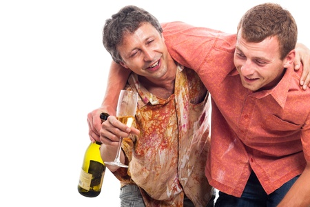 Two drunken men laughing with bottle and glass of alcohol, isolated on white background with copy space. photo