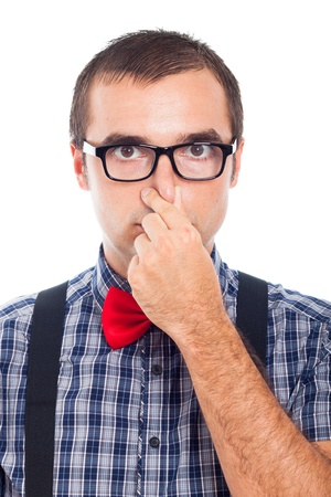 egghead: Close up of funny nerd man holding his nose, isolated on white background.