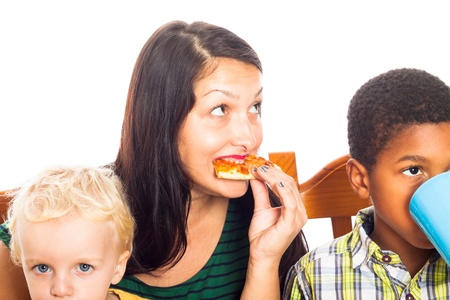 Detail of young woman with children eating pizza, isolated on white background. photo