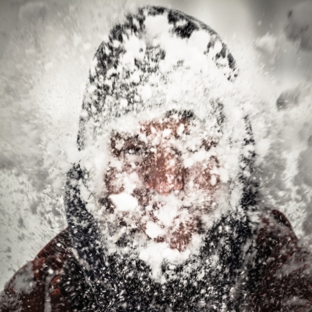 expedition: Silhouette of a man in heavy snow storm. Stock Photo