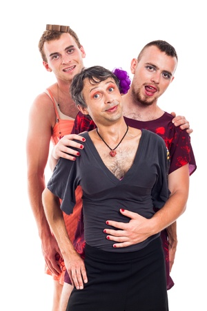 travesty: Portrait of funny transvestites cross-dressing, isolated on white background. Stock Photo