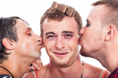 cheeks: Close up of funny transvestites kissing, isolated on white background. Stock Photo