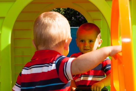 Two little brothers playing in the playhouse. photo