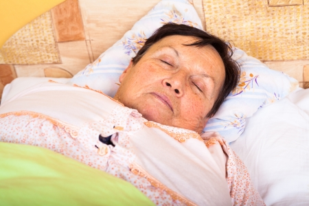 sleeping face: Close up of senior woman sleeping in bed.