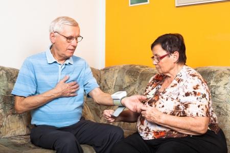 Senior couple checking blood pressure at home. Stockfoto
