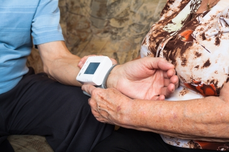 arterial: Close up of seniors checking blood pressure. Stock Photo