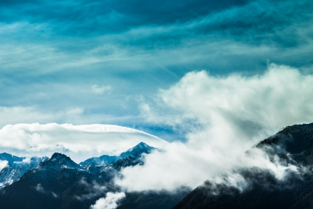 Cloudy blue sky and mountains in Southern Alps, New Zealand. Stock Photo - 17852016