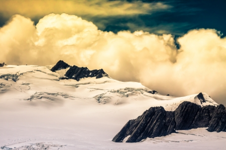 franz josef: Aerial photo of cloudscape over peak of Southern Alps in New Zealand.