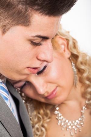 rumanian: Close up of young beautiful loving wedding couple embracing.
