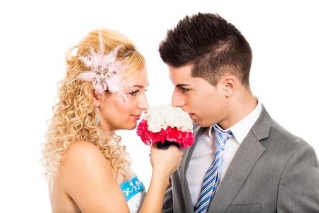 rumanian: Loving wedding couple holding flower, isolated on white background.