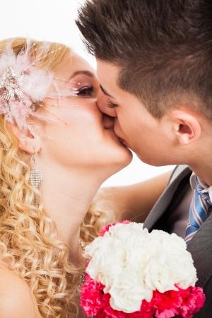 rumanian: Close up of young beautiful wedding couple kissing. Stock Photo