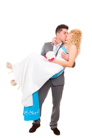 Just married wedding couple in love kissing, isolated on white background photo
