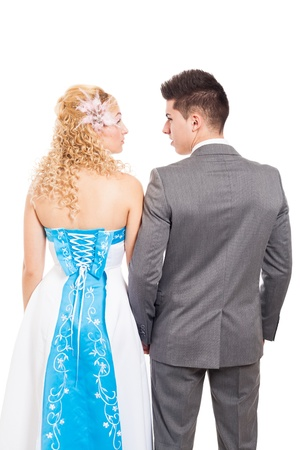 Rear view of just married wedding couple, isolated on white background photo