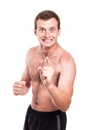 Mad shirtless man showing fist and pointing at you, isolated on white background photo