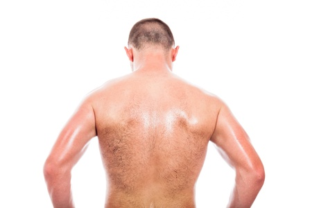 Rear view of young shirtless man, isolated on white background