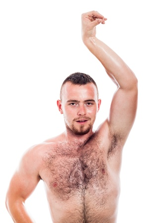 Young shirtless hairy man showing his body, isolated on white background photo