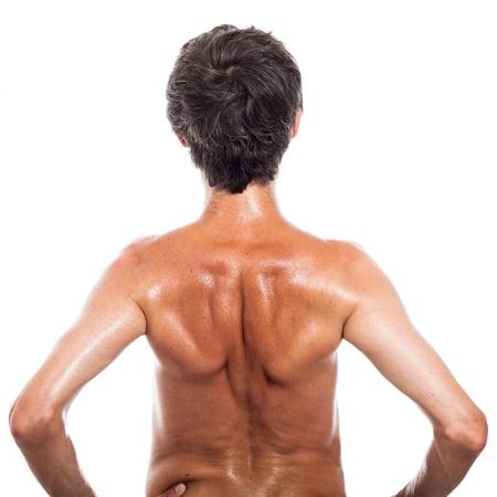 hombre flaco: Vista posterior de hombre sin camisa, aislado en fondo blanco
