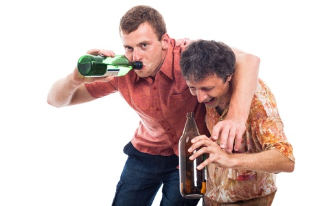 Two funny drunken men with bottle of alcohol, isolated on white background photo