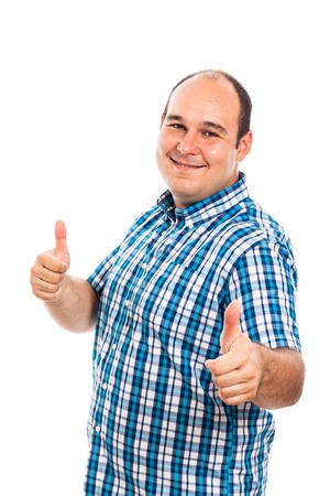 big shirt: Smiling man gesturing thumbs up, isolated on white background