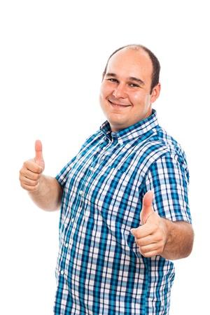 Sorridente uomo gesticolano thumbs up, isolato su sfondo bianco Archivio Fotografico - 19386927