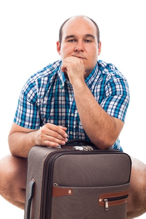 Serious man traveling with luggage, isolated on white background photo