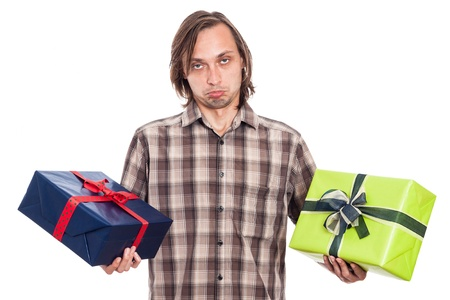 indecisive: Indecisive man holding two gift boxes, isolated on white background