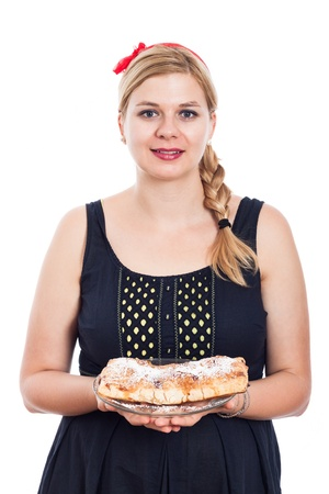 Happy woman holding homemade strudel sweet cake, isolated on white background photo