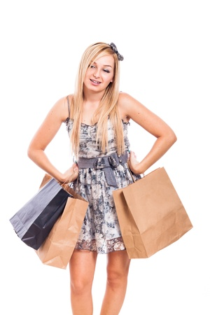 Beautiful blond girl holding shopping bags, isolated on white background photo