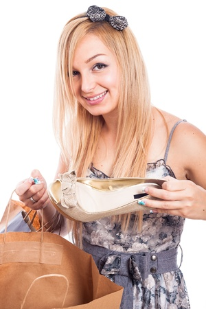 Beautiful blond smiling girl shopping shoes, isolated on white background photo