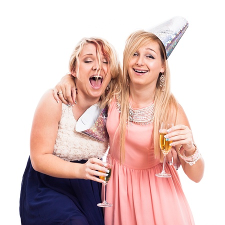 Two ecstatic drunken girls celebrate with alcohol, isolated on white background