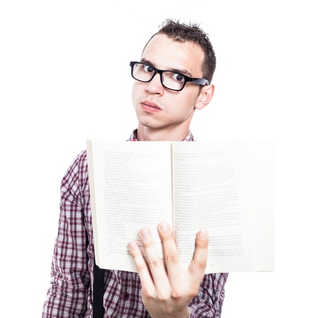 Serious male student holding book, isolated on white background photo