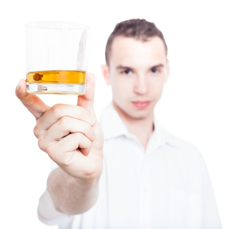 Man holding glass of whiskey, isolated on white background photo