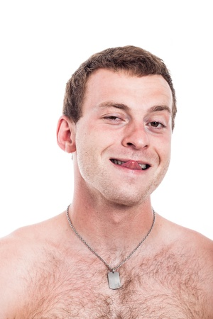 Closeup of funny shirtless man sticking out tongue, isolated on white background photo