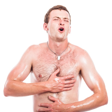 oiled: Ecstatic shirtless man touching his body, isolated on white background Stock Photo