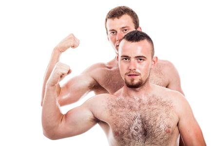 hombres sin camisa: Dos hombres sin camisa mostrando b�ceps, aislados en fondo blanco Foto de archivo